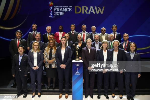 All 24 national coaches appear on stage following the FIFA Women's World Cup France 2019 Draw at La Seine Musicale on December 8, 2018 in Paris,...