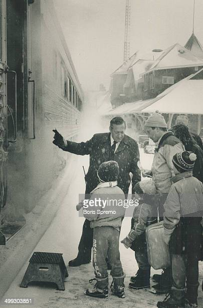All aboard A group of passengers gets ready to board VIA's transcontinental train at Kenora yesterday In northern communities many people rely on the...