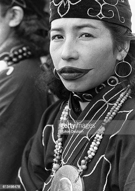All Ainu women have their lips tattooed during childhood The upper lip is slashed and then ashes are rubbed into the wound to create a scar
