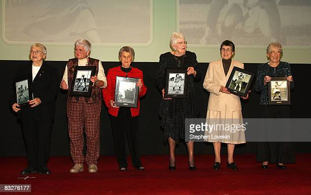 All American Girls Professional Baseball League players Thelma Eisen Isabel Alvarez Terry Donahue Jean Cione Jean Havlish and Dorothy Doyle on stage...