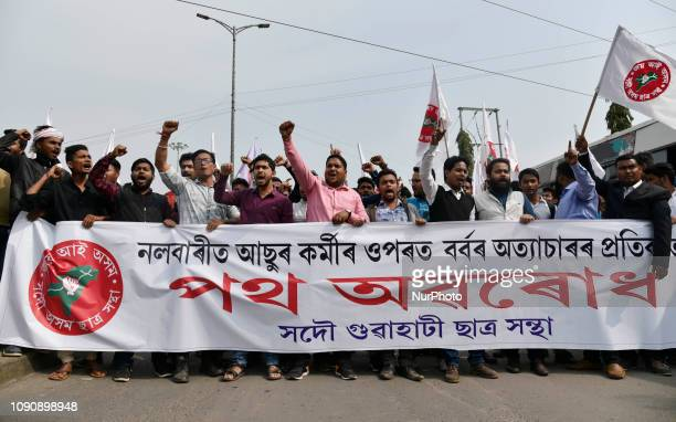 All Assam Students Union activists block National Highway 37 near Basistha during a protest against the recent attack on AASU members at Ghagrapar,...