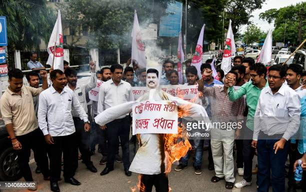 All Assam Students Union activists raise slogans and burn an effigy of Petroleum Minister Dharmendra Pradhan during a protest against the fuel price...