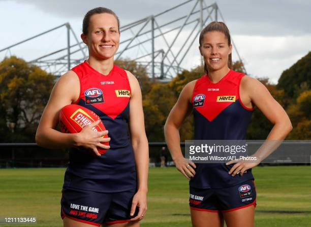 All Australian team members Karen Paxman of the Demons and Kate Hore of the Demons pose for a photograph at Princes Park on April 26 2020 in...