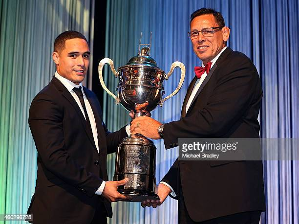All Black Aaron Smith recieves the Tom French Memorial Maori PLayer of the Year Award from Ex All Black Wayne Shelford during the 2014 Steinlager...