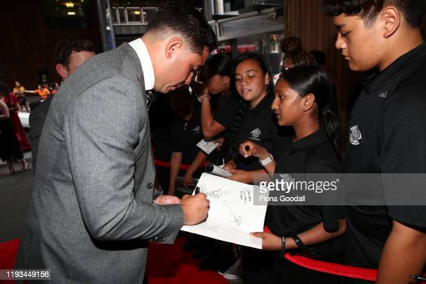 All Black Anton LienertBrown signs autographs for students from Papatoetoe Intermediate during the New Zealand Rugby Awards at the Sky City...