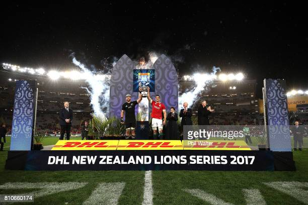 All Black captain Kieran Read and Lions captain Sam Warburton pose with the series trophy following the drawn Test match between the New Zealand All...