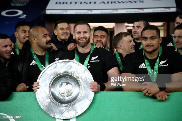 All Black captain Kieran Read and the All Blacks pose with the Hillary Shield following the Quilter International match between England and New...