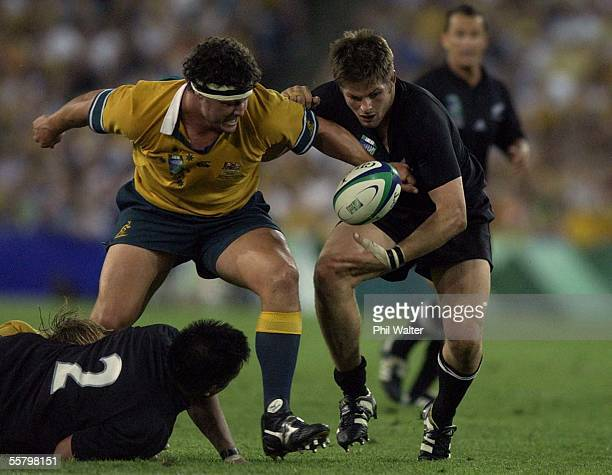 All Black captain Richard McCaw looses the ball in the tackle of Australia's Brendan Cannon in the Rugby World Cup semifinal played at Telstra...