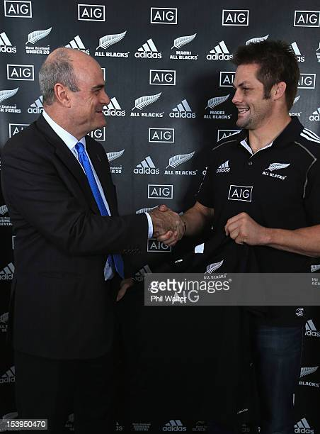 All Black captain Richie McCaw and AIG Executive Vice President Peter Hancock pose with the All Black jersey during a NZRU and AIG sponsorship...