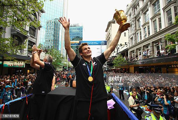 All Black Captain Richie McCaw and Coach Graham Henry hold up the Webb Ellis Cup during the New Zealand All Blacks 2011 IRB Rugby World Cup...
