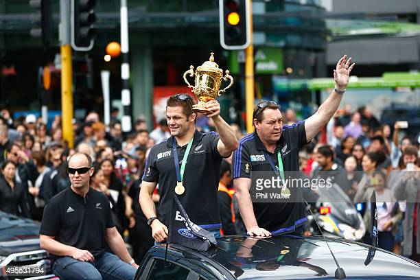 All Black captain Richie McCaw and coach Steve Hansen hold the Webb Ellis Cup aloft during the New Zealand All Blacks welcome home celebrations at...