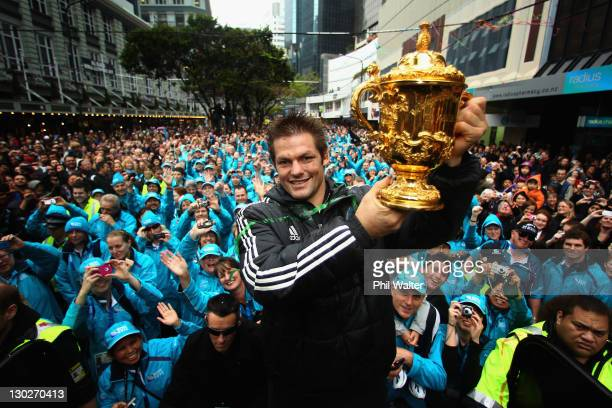All Black Captain Richie McCaw holds up the Webb Ellis Cup to the delight of the crowd during the New Zealand All Blacks 2011 IRB Rugby World Cup...