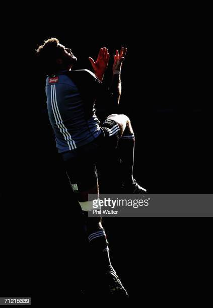 All Black captain Richie McCaw leaps in the air to catch the ball during the New Zealand All Blacks captains run at Eden Park June 16, 2006 in...