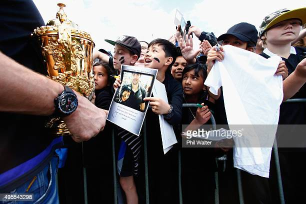 All Black captain Richie McCaw meets fans as he holds the Webb Ellis Cup during the New Zealand All Blacks welcome home celebrations at Victoria Park...