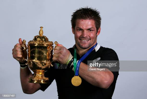 All Black captain Richie McCaw poses with the Webb Ellis Cup following his team's 87 victory during the 2011 IRB Rugby World Cup Final match between...