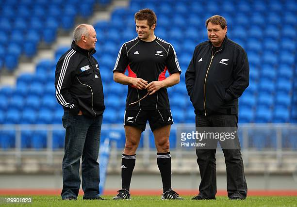 All Black Captain Richie McCaw talks with coach Graham Henry and assistant coach Steve Hansen during a New Zealand All Blacks captain's run at Trusts...
