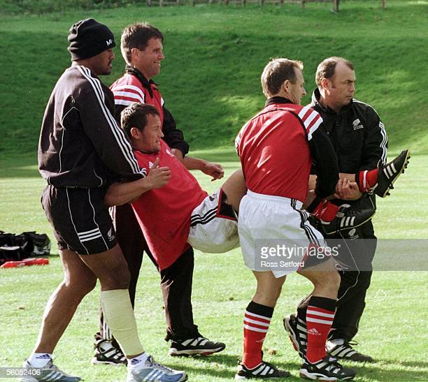 All Black Carlos Spencer is carried off the training field at All Blacks Rugby World Cup training camp at Penny Hill Country Club Bagshot Monday...