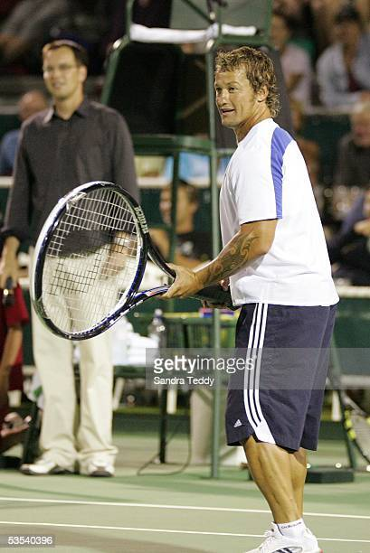 All Black Carlos Spencer uses an oversized tennis racquet to give him an advantage as he plays in an exhibition doubles match with Monica Seles...