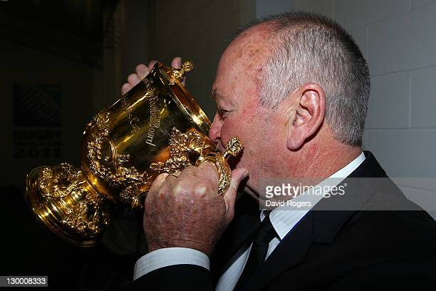 All Black coach Graham Henry drinks from the Webb Ellis Cup following his team's 87 victory during the 2011 IRB Rugby World Cup Final match between...