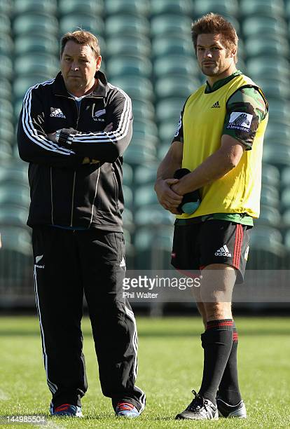 All Black coach Steve Hansen and captain Richie McCaw chat during a New Zealand All Blacks training camp session at North Harbour Stadium on May 22,...