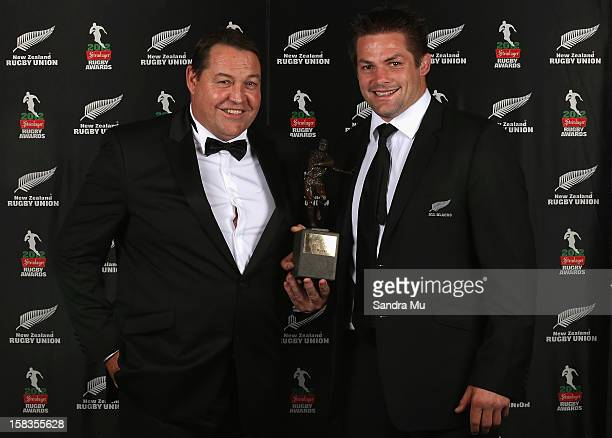 All Black coach Steve Hansen and captain Richie McCaw pose with the Team of the Year award during the 2012 Steinlager Rugby Awards at SkyCity...