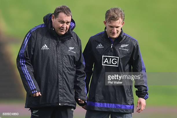 All Black coach Steve Hansen talks with Damian McKenzie during a New Zealand All Blacks training session at Trusts Stadium on May 31, 2016 in...