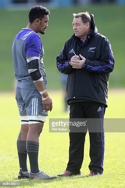 All Black coach Steve Hansen talks with Jerome Kaino during a New Zealand All Blacks training session at Trusts Stadium on June 7 2016 in Auckland...