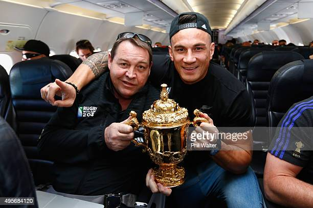 All Black coach Steve L and Sonny Bill Williams pose with the Webb Ellis Cup enroute to Christchurch for the New Zealand All Blacks welcome home...