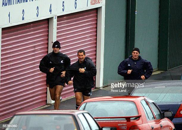 All Black coaches John Mitchell Robbie Deans and Daryl Halligan run back to their hotel following the teams final training run at Carisbrook befor...