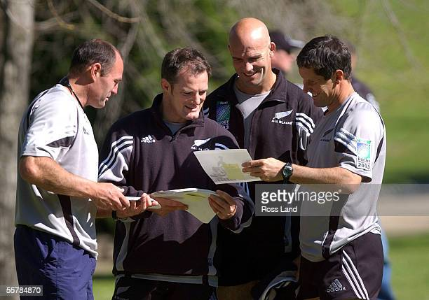 All Black coaching support staff Daryl Halligan and Ross Nesdale coach John Mitchell and coaching coordinator Robbie Deans at team training in...