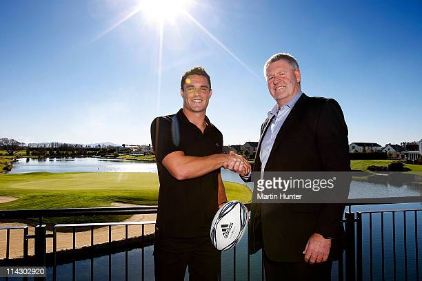 All Black Daniel Carter poses with Steve Tew CEO of the New Zealand Rugby Union after his announcement regarding his resigning with the NZRU at...
