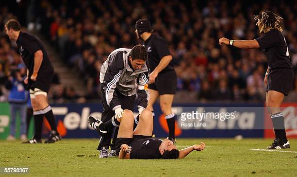 All Black Doctor John Mayhew treats Daniel Carter's injury during the All Blacks 707 win over Italy in their Rugby World Cup match at the Telstra...