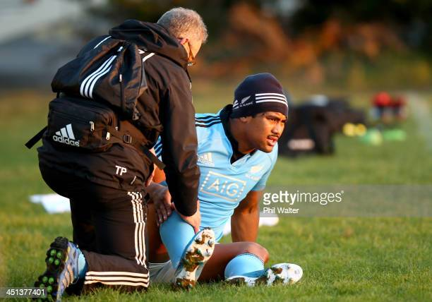 All Black doctor Tony Page tends to Julian Savea during a New Zealand All Blacks training session at the Westmanstown Sport and Conference Centre on...
