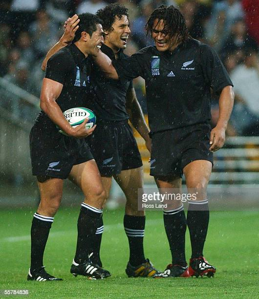 All Black fullback Mils Muliaina is congratulated by Doug Howlett and Rodney So'oialo after scoring the second of his two tries during New Zealand's...