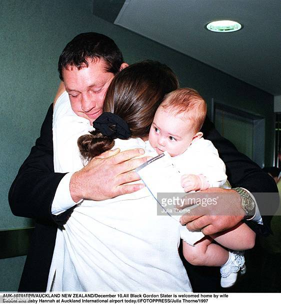 All Black Gordon Slater is welcomed home by wife rDebbie and baby Hannah at Auckland International airport todayFOTOPPRESS