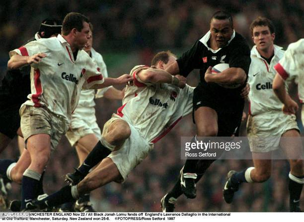 All Black Jonah Lomu fends off England's Lawrence Dallaglio in the international at Old Trafford Manchester Saturday New Zealand won 258