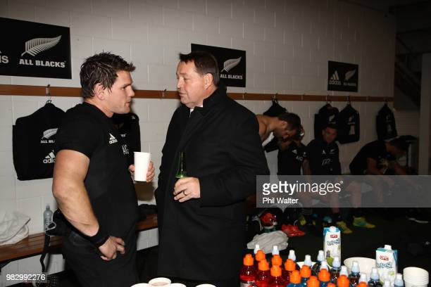All Black Matt Todd speaks with coach Steve Hansen in the dressing room following the International Test match between the New Zealand All Blacks and...