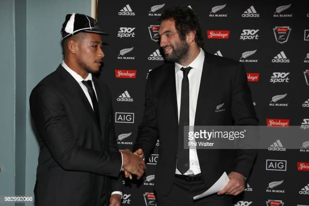All Black Shannon Frizell is presented with his test cap from Sam Whitelock following the International Test match between the New Zealand All Blacks...