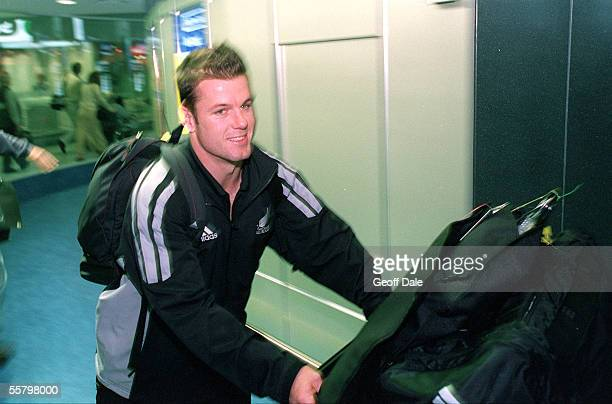 All Black Steve Devine walks through Arrivals with his baggage at the Auckland international airport as the All Blacks arrive home from their end of...