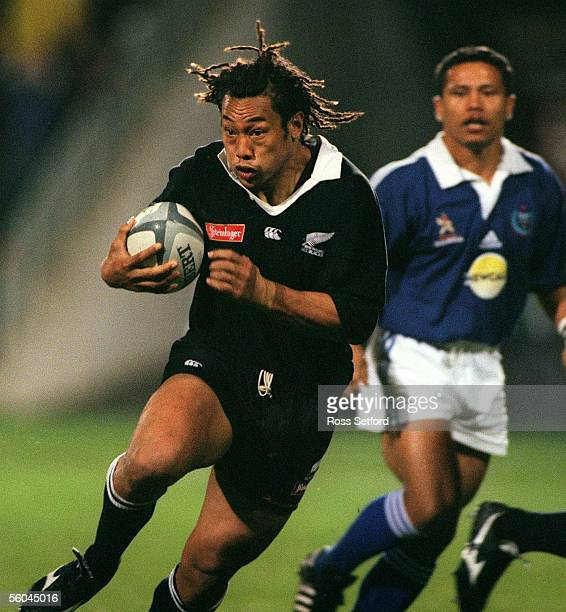 All Black Tana Umaga in front of Manu Samoa's Afato So'oalo at North Harbour Stadium Albany Friday The All Blacks won 7113