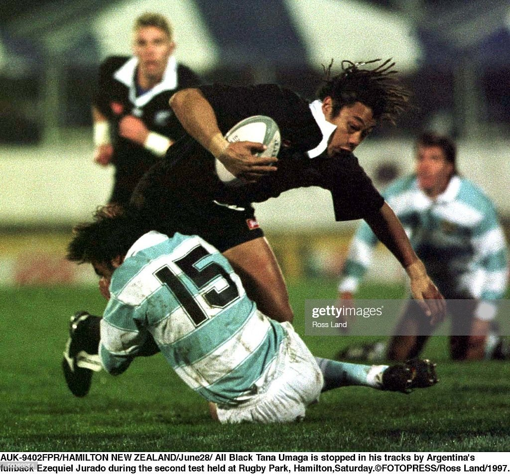 All Black Tana Umaga is stopped in his tracks by A : News Photo