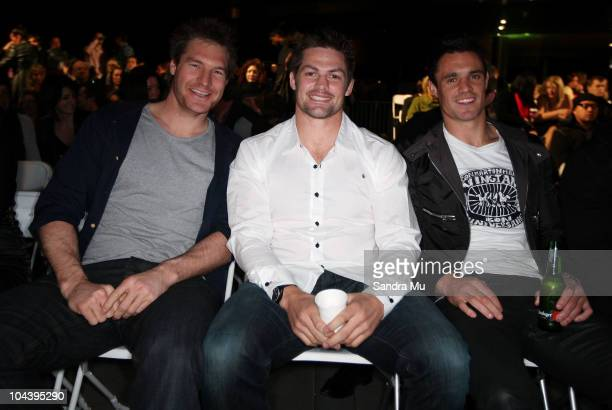 All Blacks Ali Williams Richie McCaw and Daniel Carter are seen in the front row during the Huffer show as part of New Zealand Fashion Week 2010 on...