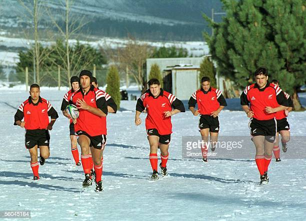 All Blacks Andrew Blowers and Taine Randell lead the training in the snow in Queenstown Saturday