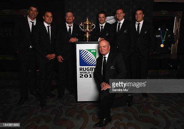 All Blacks Anthony Boric, Israel Dagg, Tony Woodcock, Graham Henry, Richie McCaw, Kieran Read and Richard Kahui pose with the Rugby World Cup during...
