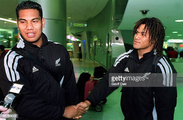 All Blacks Bradley Mika and Rodney So'oalio shake hands as they talk to the media after arriving back at the Auckland International Airport as the...