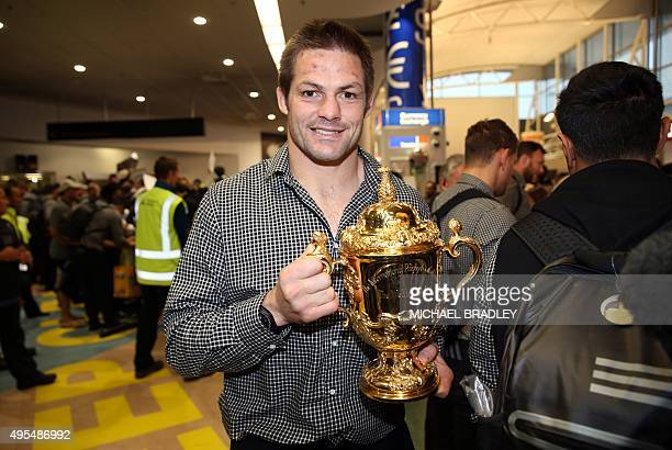 All Blacks captain Richie McCaw arrives back home with the Rugby World Cup trophy at the Auckland Airport in Auckland on November 04 2015 The New...