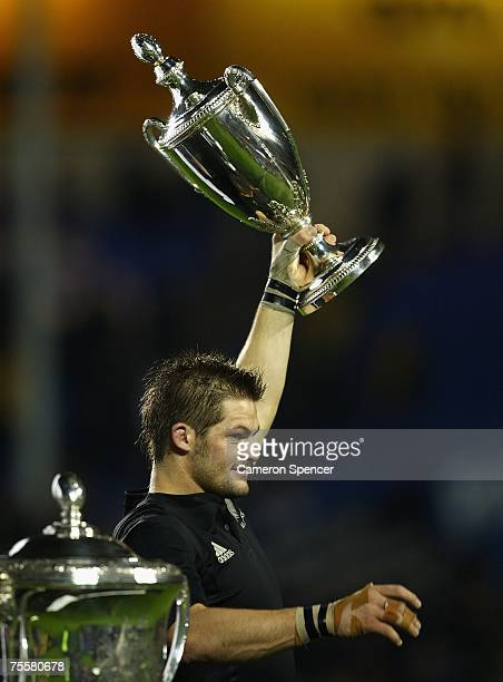 All Blacks captain Richie McCaw holds the Tri Nations trophy aloft after winning the 2007 Tri Nations series Bledisloe Cup match between the New...