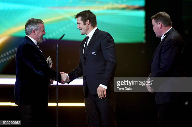 All Blacks Captain Richie McCaw is presented with the Laureus World Team of the Year trophy from Laureus World Sports Academy member Sean Fitzpatrick...