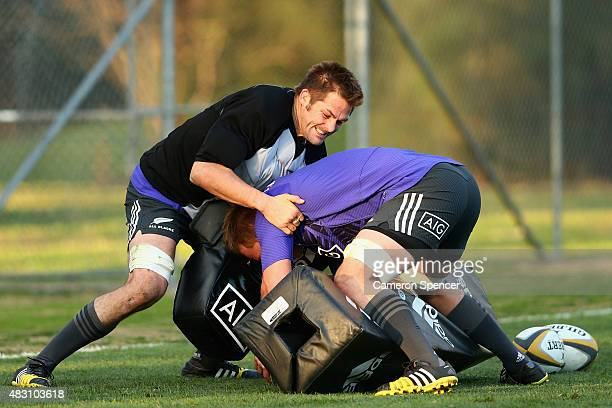 All Blacks captain Richie McCaw makes a tackle during a New Zealand All Blacks training session at Wilson Park on August 6 2015 in Sydney Australia