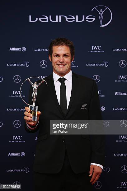 All Blacks Captain Richie McCaw on behalf of the All Blacks rugby team poses with the Laureus World Team of the Year trophy at the Messe Berlin on...